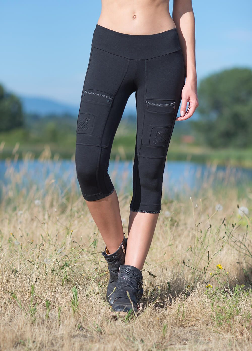 Organic cotton and bamboo 3/4 leggings with print showing thigh shreds and pockets on model, by Nomads Hemp Wear.