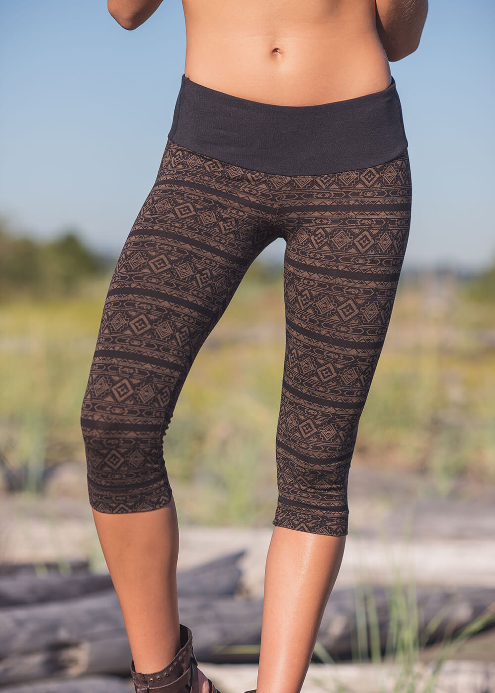 Organic cotton and bamboo 3/4 printed leggings with wide waistband on model, by Nomads Hemp Wear.