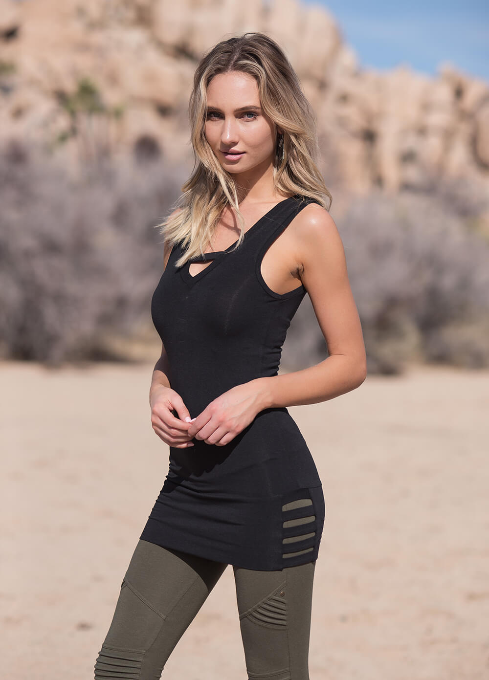 Organic cotton and bamboo v-neck, bodycon tunic with cutouts on model by Nomads Hemp Wear.