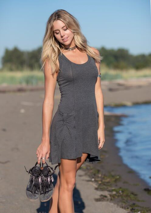 Organic cotton and bamboo dress with pockets on model at a beach, by Nomads Hemp Wear.