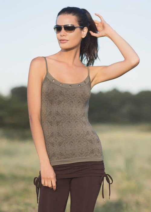 Model in glasses wearing an olive coloured tank top with grommets in organic cotton and bamboo