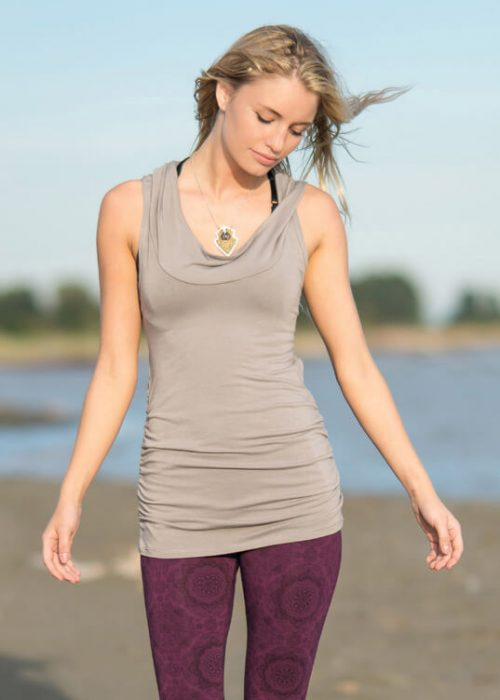 arcana bamboo tunic - hooded tunic on a blonde girl on the beach