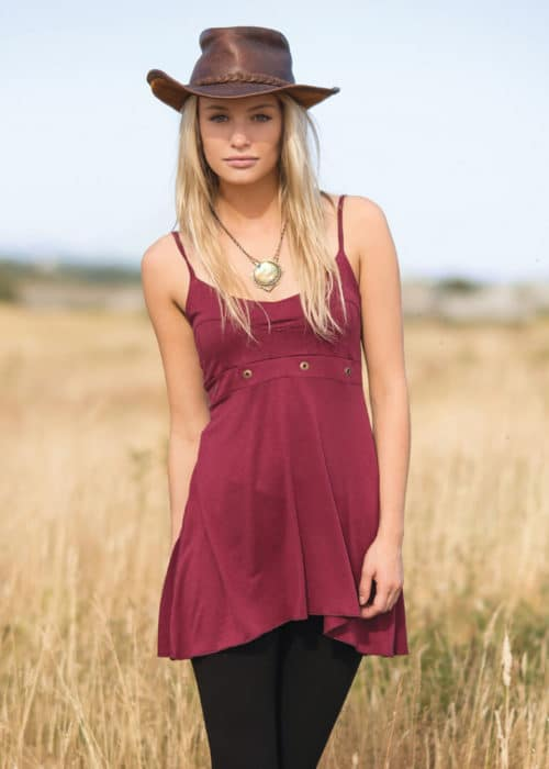 NIrvana Babydoll bamboo dress by nomads hempwear in red on a blonde model with a cowboy hat